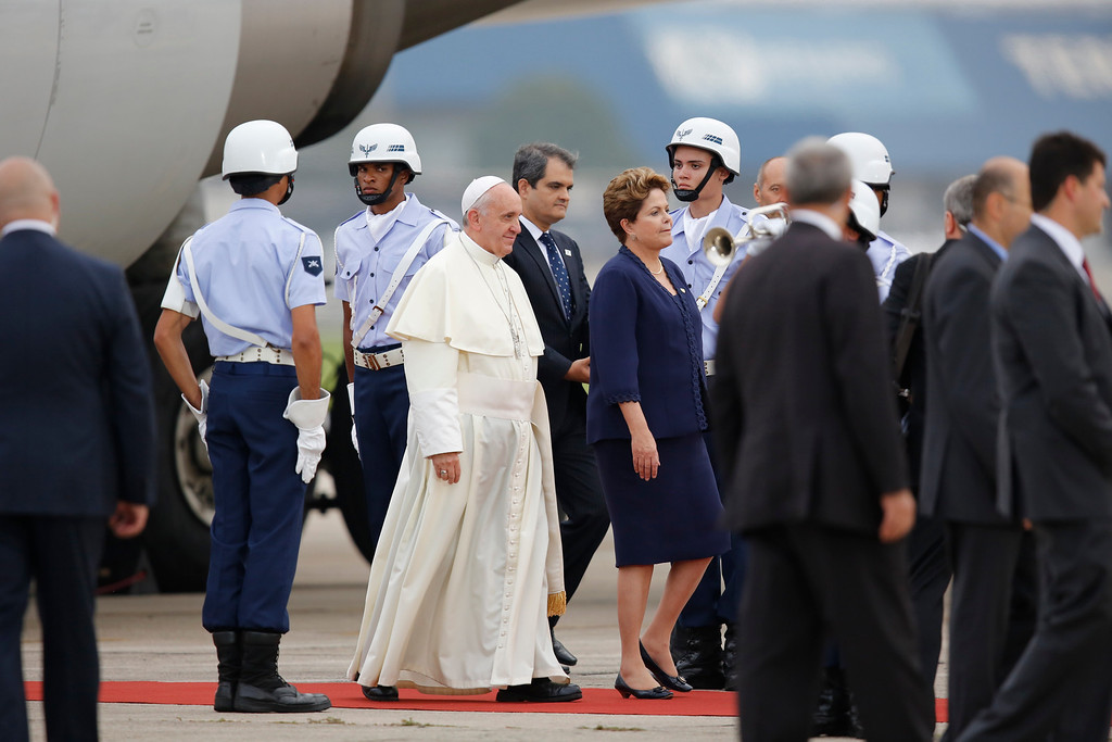 . Pope Francis walks accompanied by Brazil\'s President Dilma Rousseff upon his arrival at the international airport in Rio de Janeiro, Brazil, Monday, July 22, 2013. During his seven-day visit, Francis will meet with legions of young Roman Catholics converging on Rio for the church\'s World Youth Day festival. (AP Photo/Jorge Saenz)