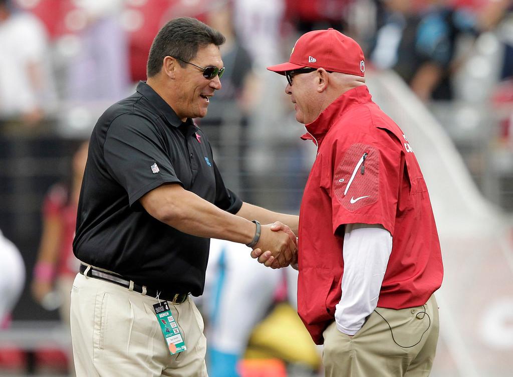 . Arizona Cardinals head coach Bruce Arians, right, greets Carolina Panthers head coach Ron Rivera, prior to a NFL football game, Sunday, Oct. 6, 2013, in Glendale, Ariz. (AP Photo/Rick Scuteri)