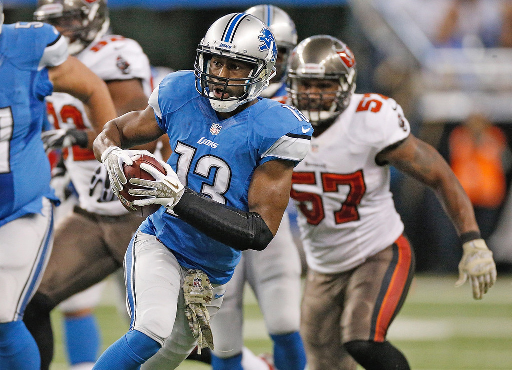 . Nate Burleson #13 of the Detroit Lions makes a catch and heads up field against the Tampa Bay Buccaneers at Ford Field on November 24, 2013 in Detroit, Michigan. (Photo by Gregory Shamus/Getty Images)