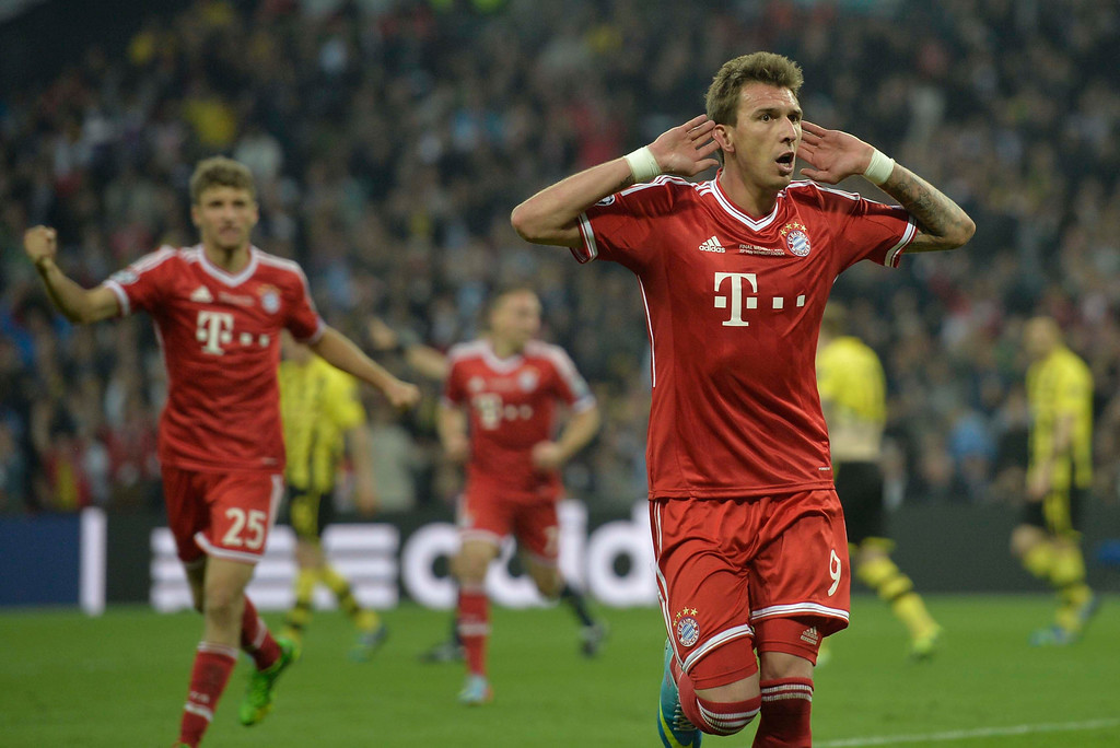 . Bayern\'s Mario Mandzukic of Croatia celebrates scoring, during the Champions League Final soccer match between  Borussia Dortmund and Bayern Munich at Wembley Stadium in London, Saturday May 25, 2013. (AP Photo/Martin Meissner)