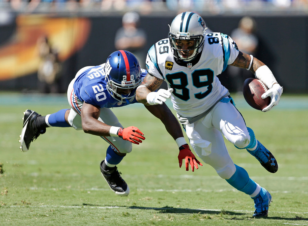 . Carolina Panthers\' Steve Smith (89) runs after a catch against New York Giants\' Prince Amukamara (20) during the first half of an NFL football game in Charlotte, N.C., Sunday, Sept. 22, 2013. (AP Photo/Bob Leverone)