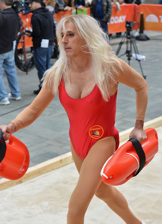 . Matt Lauer, dressed as Pamela Anderson\'s \'Baywatch\' character C. J. Parker, attends NBC\'s \'Today\' Halloween 2013 in Rockefeller Plaza on October 31, 2013 in New York City.  (Photo by Slaven Vlasic/Getty Images)