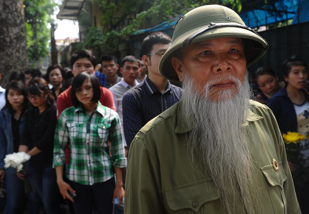 . A Vietnam War veteran lines up among thousands of others outside the residence of late General Vo Nguyen Giap before entering to pay homage to the national independence hero in Hanoi on October 6, 2013. Vietnam announced plans to hold a national funeral for independence hero General Vo Nguyen Giap in the first official statement on the death of the ruthless but brilliant military strategist .  HOANG DINH NAM/AFP/Getty Images