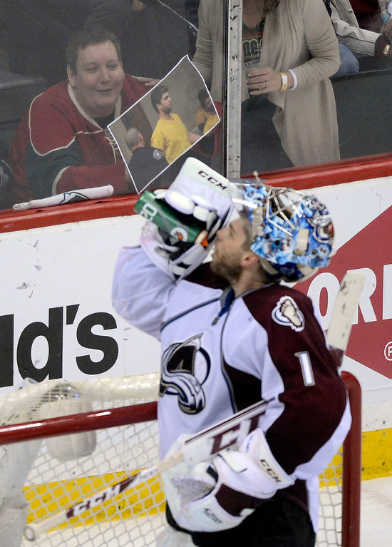 . A Minnesota fan tried to distract Colorado goalie Semyon Varlamov with a picture taken in court. The Minnesota Wild defeated the Colorado Avalanche 5-2 Monday night, April 28, 2014 at the Xcel Energy Center in St. Paul. (Photo by Karl Gehring/The Denver Post)