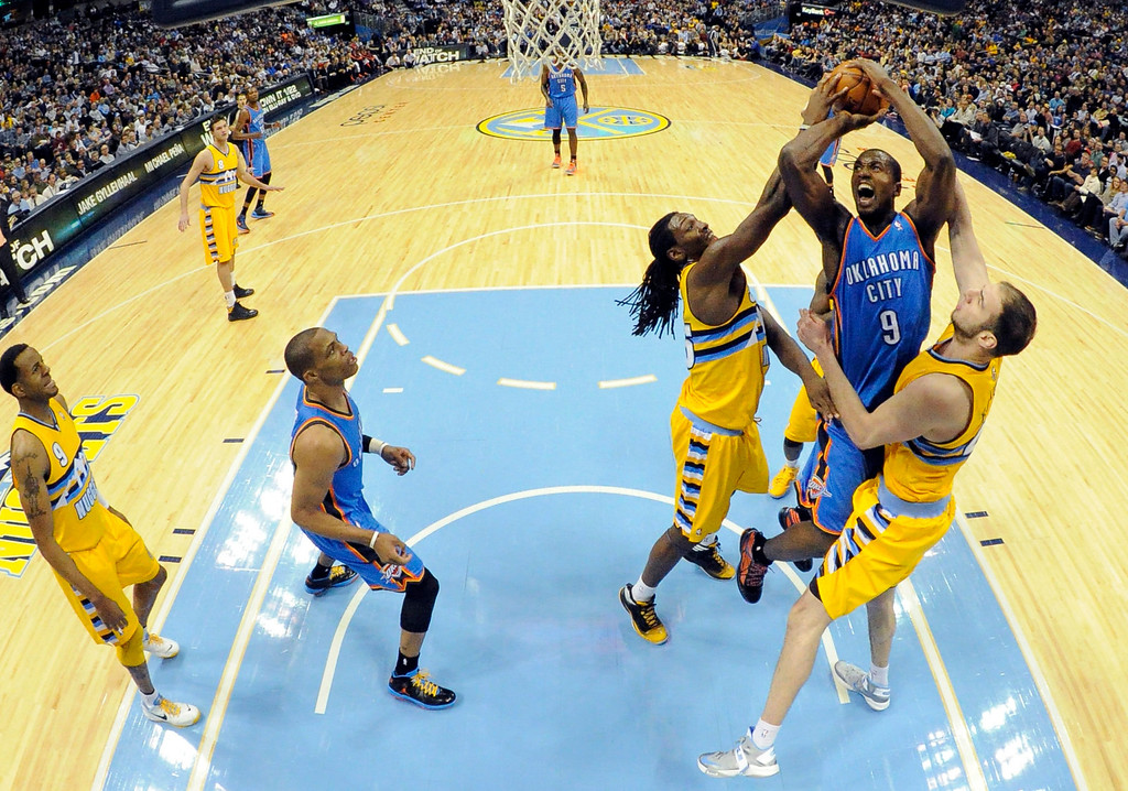 . DENVER, CO. - JANUARY 20: Oklahoma City Thunder power forward Serge Ibaka (9) gets his shot blocked by Denver Nuggets small forward Kenneth Faried (35) as Denver Nuggets center Kosta Koufos (41) helps out during the fourth quarter January 20,  2013 at Pepsi Center. The Denver Nuggets defeated the Oklahoma City Thunder 121-118.  (Photo By John Leyba / The Denver Post)