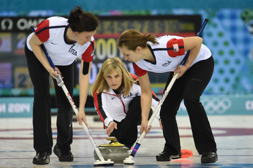 . US Erika Brown (C) throws the stone during the Women\'s Curling Round Robin Session 6 Japan vs USA at the Ice Cube Curling Center during the Sochi Winter Olympics on February 13, 2014. DAMIEN MEYER/AFP/Getty Images