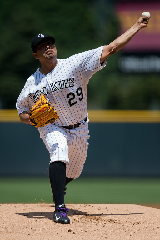 . DENVER, CO - JULY 23:  Starting pitcher Jorge De La Rosa #29 of the Colorado Rockies delivers to home plate during the first inning against the Washington Nationals at Coors Field on July 23, 2014 in Denver, Colorado. (Photo by Justin Edmonds/Getty Images)
