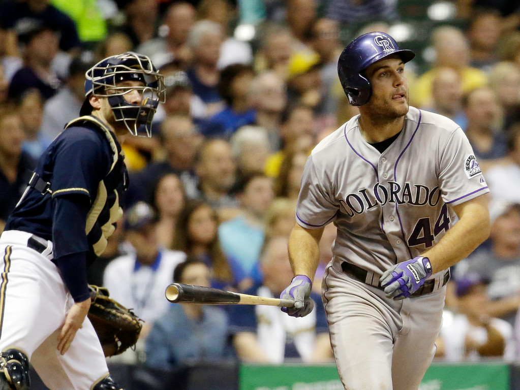 . Milwaukee Brewers catcher Jonathan Lucroy watches as Colorado Rockies\' Ryan Wheeler hits a grand slam during the fourth inning of a baseball game Thursday, June 26, 2014, in Milwaukee. (AP Photo/Morry Gash)