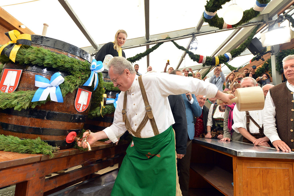 ". Munich\'s Mayor Christian Ude taps the first barrel of beer with the traditional ""O´zapft is!\"" (It\'s tapped!) to open the Oktoberfest beer festival at the Theresienwiese in Munich, southern Germany, on September 21, 2013. The world\'s biggest beer festival Oktoberfest will run until October 6, 2013.  AFP PHOTO / DPA / PETER KNEFFEL/AFP/Getty Images"