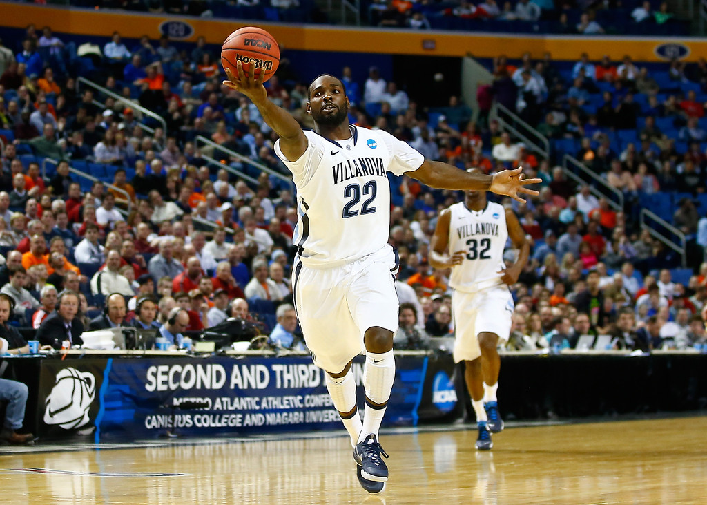 . BUFFALO, NY - MARCH 20: JayVaughn Pinkston #22 of the Villanova Wildcats catches a pass against the Milwaukee Panthers during the second round of the 2014 NCAA Men\'s Basketball Tournament at the First Niagara Center on March 20, 2014 in Buffalo, New York.  (Photo by Jared Wickerham/Getty Images)