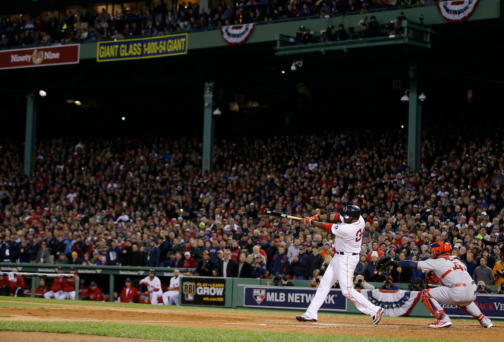 . Boston Red Sox\'s David Ortiz hits a two-run home run during the sixth inning of Game 2 of baseball\'s World Series against the St. Louis Cardinals Thursday, Oct. 24, 2013, in Boston. (AP Photo/Matt Slocum)