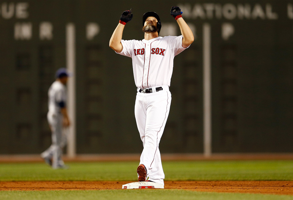 . David Ross #3 of the Boston Red Sox reacts after hitting a double in the third inning against the Tampa Bay Rays during Game Two of the American League Division Series at Fenway Park on October 5, 2013 in Boston, Massachusetts.  (Photo by Jim Rogash/Getty Images)