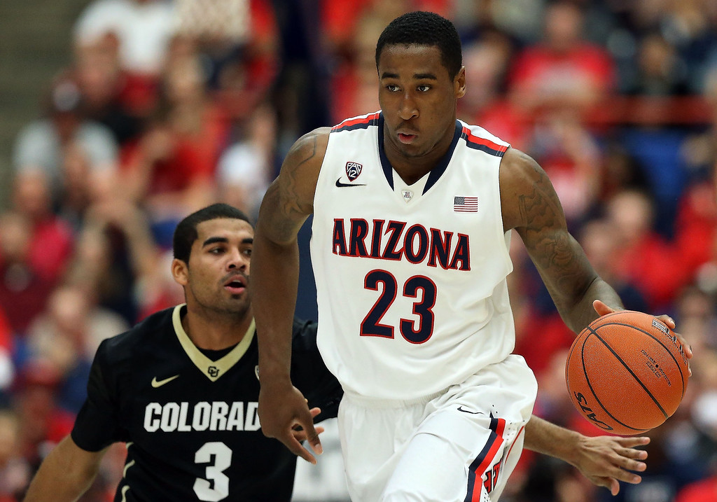. Rondae Hollis-Jefferson #23 of the Arizona Wildcats moves the ball upcourt past Xavier Talton #3 of the Colorado Buffaloes during the first half of the college basketball game at McKale Center on January 23, 2014 in Tucson, Arizona.  (Photo by Christian Petersen/Getty Images)