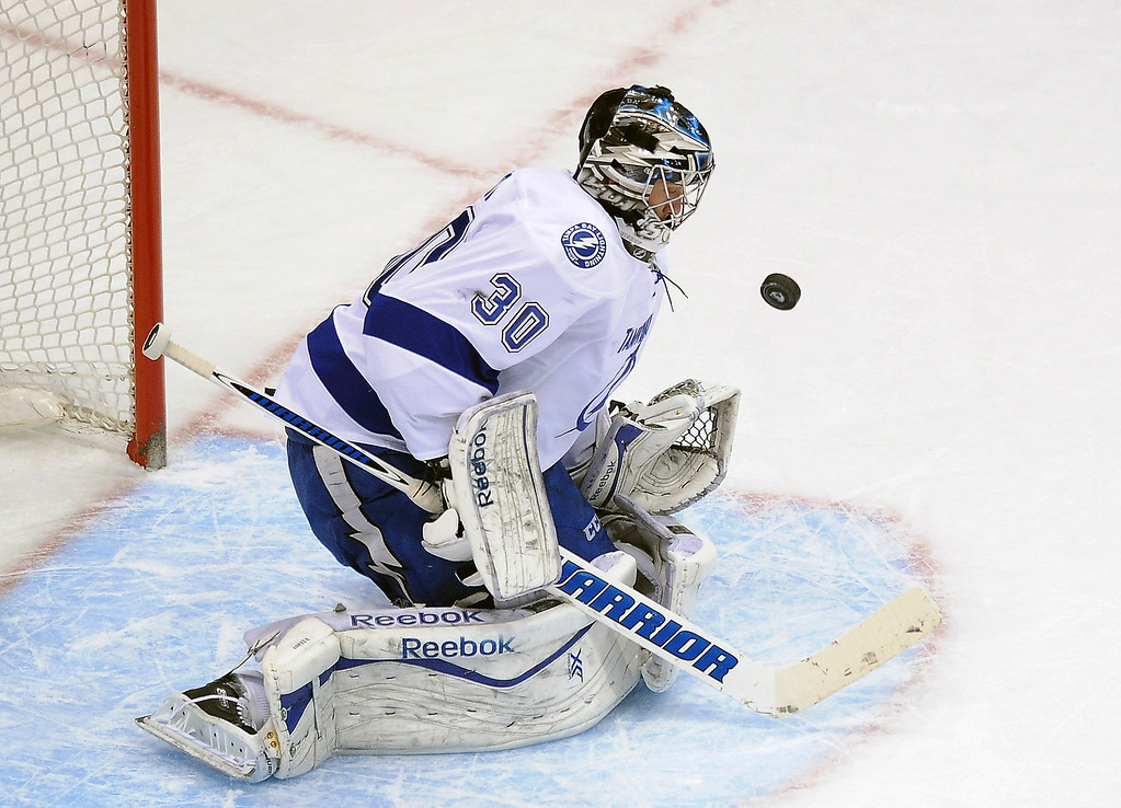 . Tamp Bay Lightning goalie Ben Bishop makes a save in the first period of an NHL hockey game against the Colorado Avalanche on Sunday, March 2, 2014 in Denver. (AP Photo/Chris Schneider)