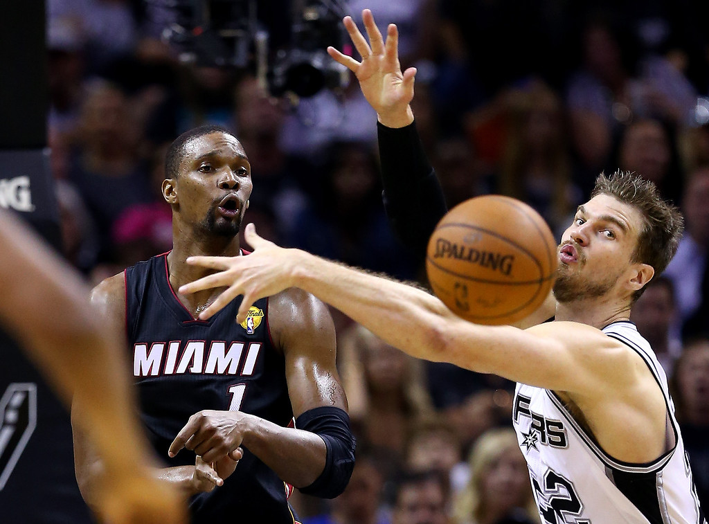 . Tiago Splitter #22 of the San Antonio Spurs defends against Chris Bosh #1 of the Miami Heat during Game Two of the 2014 NBA Finals at the AT&T Center on June 8, 2014 in San Antonio, Texas.  (Photo by Andy Lyons/Getty Images)