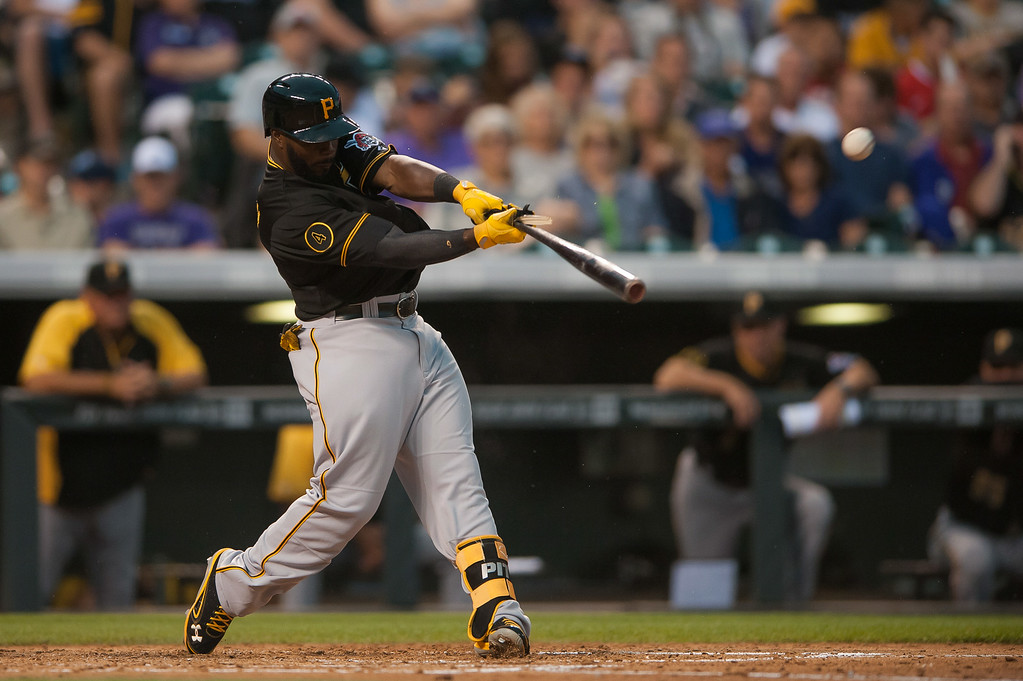 . Josh Harrison #5 of the Pittsburgh Pirates breaks his bat on a fly out against the Colorado Rockies at Coors Field on July 26, 2014 in Denver, Colorado.  (Photo by Dustin Bradford/Getty Images)