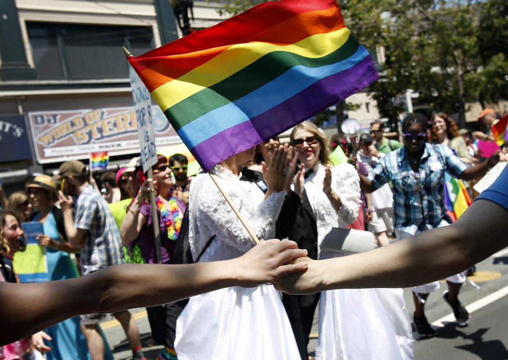 . Bend the Arc, a Jewish social justice group, dances around two women dressed as brides during the 43rd annual San Francisco Lesbian, Gay, Bisexual, Transgender (LGBT) Pride Celebration & Parade June 30, 2013, in San Francisco, California.  The annual S.F. Pride Parade occurred just days after same-sex marriages were reinstated in California following the recent Supreme Court rulings.  (Photo by Sarah Rice/Getty Images)