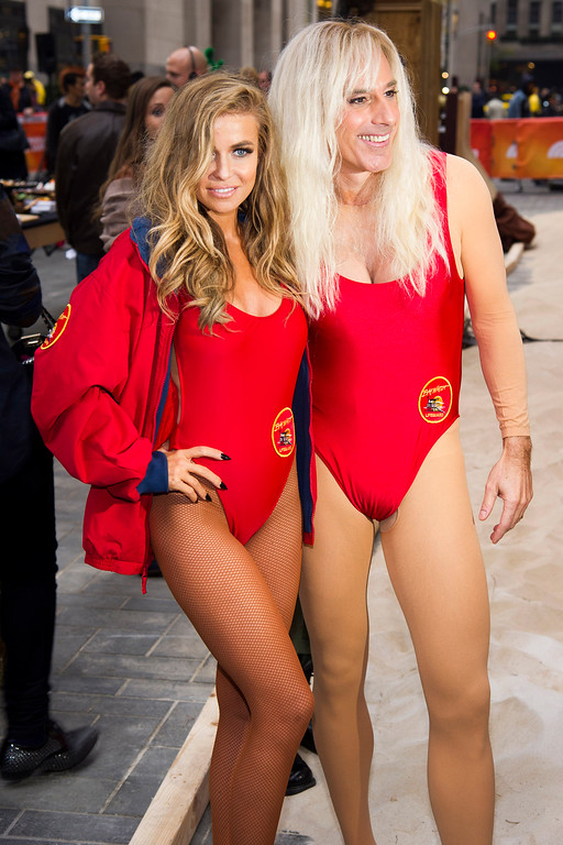 """. Former \""""Baywatch\"""" star Carmen Electra poses with Matt Lauer, dressed as Pam Anderson\'s character C.J. Parker, on NBC\'s \""""Today\"""" Halloween show on Thursday, Oct. 31, 2013 in New York. (Photo by Charles Sykes/Invision/AP)"""