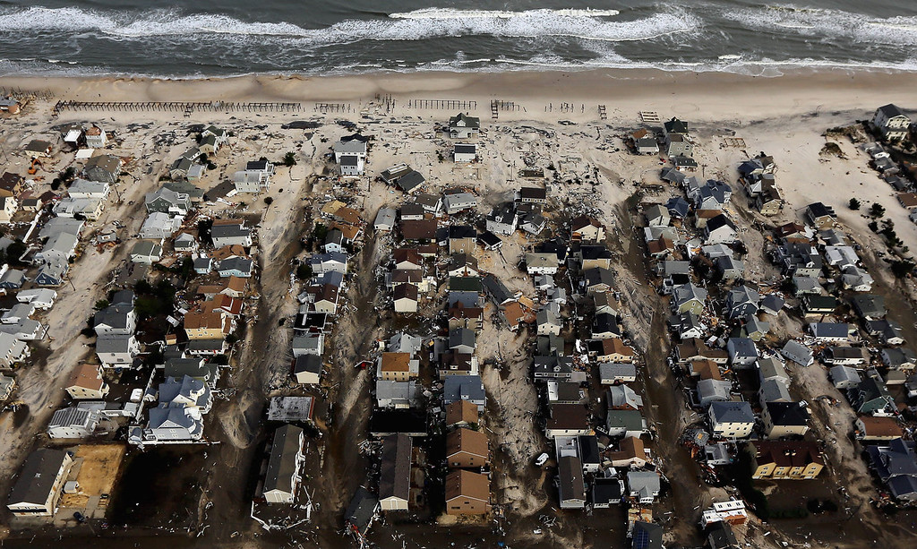 . Homes sit in ruin next to the Atlantic Ocean after being destroyed by Hurricane Sandy on October 31, 2012 in Seaside Heights, New Jersey.  At least 50 people were reportedly killed in the U.S. by Sandy with New Jersey suffering massive damage and power outages.  (Photo by Mario Tama/Getty Images)