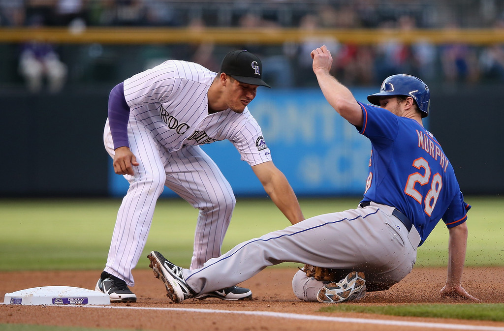 . DENVER, CO - MAY 02:  Daniel Murphy #28 of the New York Mets is tagged out by third baseman Nolan Arenado #28 of the Colorado Rockies attempting to steal third base in the first inning at Coors Field on May 2, 2014 in Denver, Colorado.  (Photo by Doug Pensinger/Getty Images)