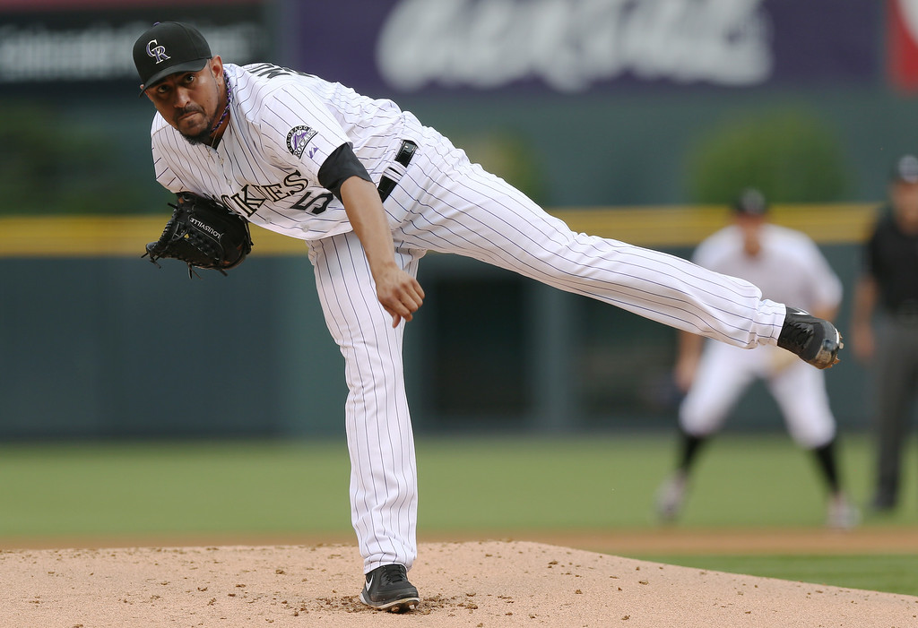 . Colorado Rockies starting pitcher Franklin Morales works against the Los Angeles Dodgers in the first inning of a baseball game in Denver on Thursday, July 3, 2014. (AP Photo/David Zalubowski)