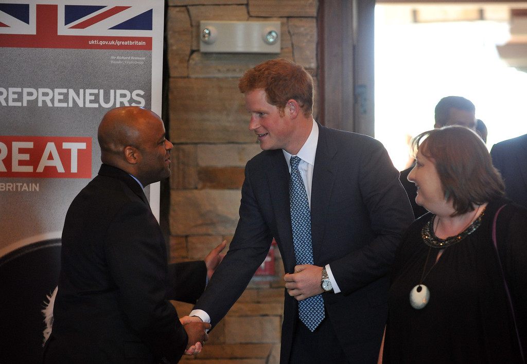 . SEDALIA, CO. - MAY 10 : Denver Mayor Michael Hankock, left, welcomes Prince Harry at Club House of Sanctuary Golf Course in Sedalia, Colorado. May 10, 2013. (Photo By Hyoung Chang/The Denver Post)