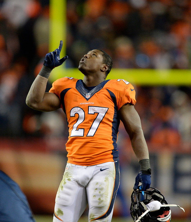 . Denver Broncos running back Knowshon Moreno (27) gives thanks as the Denver Broncos beat the San Diego Chargers 24-17. The Denver Broncos vs. The San Diego Chargers in an AFC Divisional Playoff game at Sports Authority Field at Mile High in Denver on January 12, 2014. (Photo by John Leyba/The Denver Post)