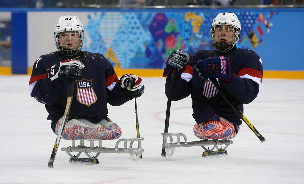. Joshua Pauls (L) and Brody Roybal (R) seen during a group stage Ice Sledge Hockey match against Russia at Sochi 2014 Paralympic Games, Russia, 08 March 2014.  EPA/SERGEI CHIRIKOV