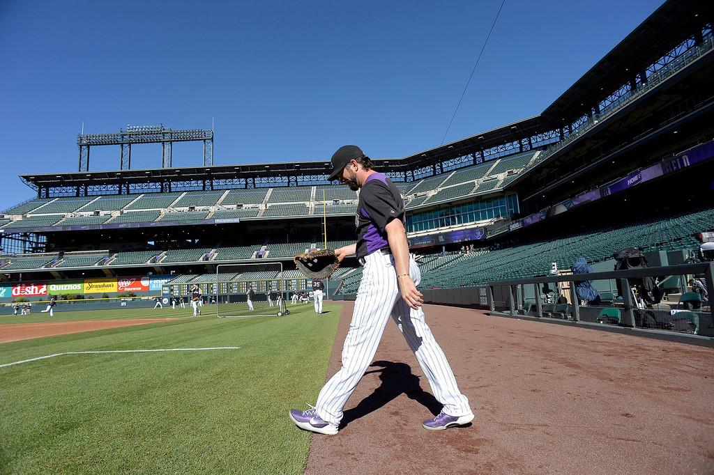 . Todd Helton (17) of the Colorado Rockies walks out to the field for batting practice for the last time as a member of the Colorado Rockies September 25, 2013 at Coors Field. Helton will retire at the end of the season after 17 years with the club. (Photo By John Leyba/The Denver Post)