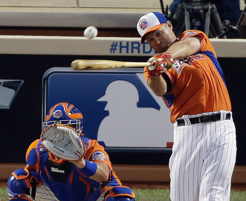 . National League\'s Michael Cuddyer, of the Colorado Rockies, hits during the MLB All-Star baseball Home Run Derby, Monday, July 15, 2013, in New York. (AP Photo/Frank Franklin II)