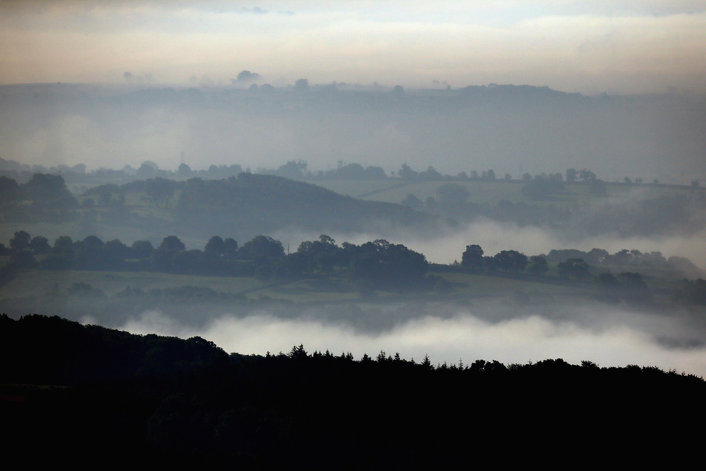 . The dawn sun begins to clear the mist and fog lingering in fields close to the city of Wells on September 4, 2013 in Somerset, England. (Photo by Matt Cardy/Getty Images)