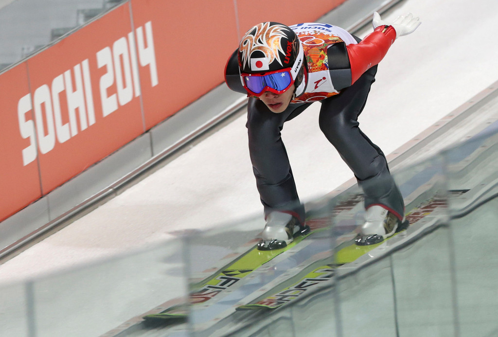. Japan\'s Taku Takeuchi starts an attempt during the men\'s normal hill ski jumping qualification at the 2014 Winter Olympics, Saturday, Feb. 8, 2014, in Krasnaya Polyana, Russia. (AP Photo/Matthias Schrader)