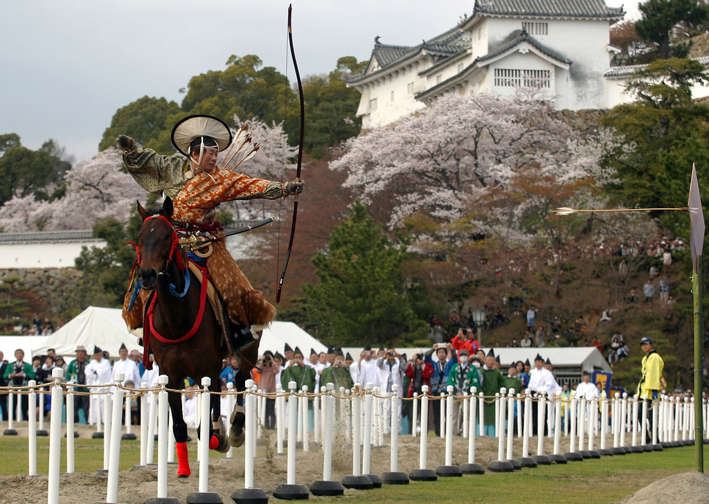 . HIMEJI, JAPAN - APRIL 03:  Japanese archer rides a horse while he performs traditional archery to entertain the gods during the Mitsuyama Taisai Festival of Itate Hyozu Shrine on April 3, 2013 in Himeji, Japan. The festival has been held once every 20 years since 1593. Priests of Itate Hyozu Shrine welcome all the gods across the country on the night of March 31st from the top of the \'three mountains\' and treat with food for seven days to April 7 praying for peace and prosperity. (Photo by Buddhika Weerasinghe/Getty Images)