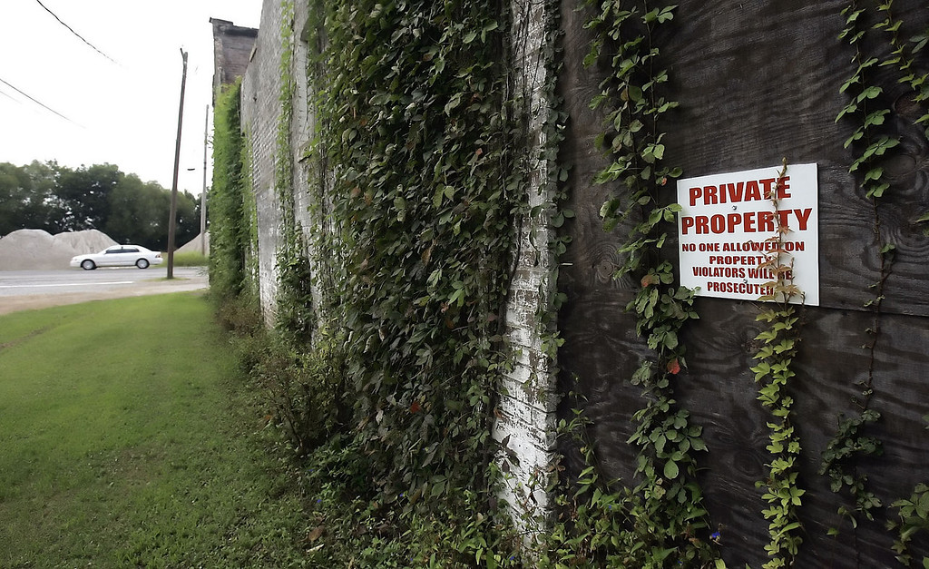 . Ivy and warning signs are on the exterior walls of the two-story, whitewashed brick building that was Bryant\'s Grocery & Meat Market in Money, Miss., Aug. 12, 2005. The store is where Emmett Till, a 14-year-old black youth whistled at the owner\'s wife and subsequently paid for the action with his life in August 1955. (AP Photo/Rogelio Solis)
