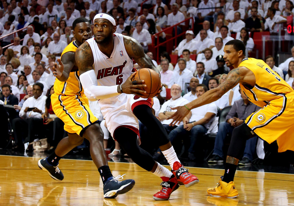 . MIAMI, FL - MAY 30:  LeBron James #6 of the Miami Heat drives to the basket against Lance Stephenson #1 of the Indiana Pacers during Game Six of the Eastern Conference Finals of the 2014 NBA Playoffs at American Airlines Arena on May 30, 2014 in Miami, Florida.  (Photo by Mike Ehrmann/Getty Images)