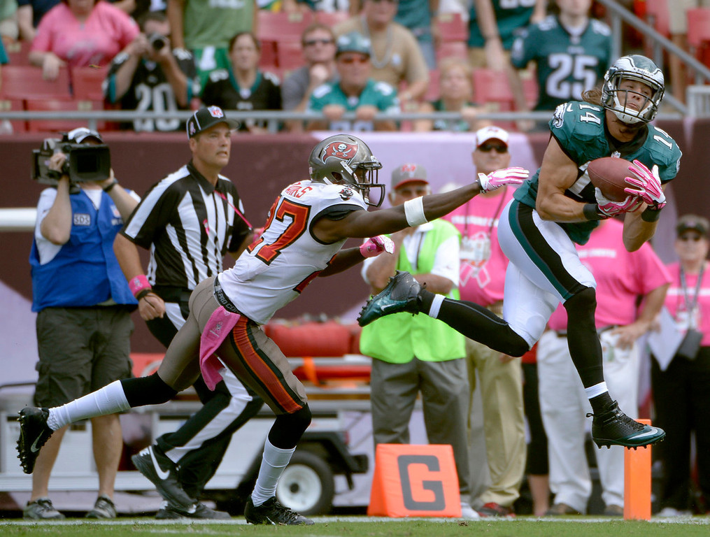 . Philadelphia Eagles wide receiver Riley Cooper (14) pulls in a 47-yard touchdown reception in front of Tampa Bay Buccaneers cornerback Johnthan Banks (27) during the third quarter of an NFL football game Sunday, Oct. 13, 2013, in Tampa, Fla. (AP Photo/Phelan M. Ebenhack)