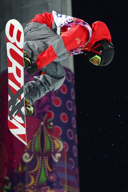 . China\'s Shi Wancheng competes in the Men\'s Snowboard Halfpipe Semifinals at the Rosa Khutor Extreme Park during the Sochi Winter Olympics on February 11, 2014.           AFP PHOTO / JAVIER SORIANO/AFP/Getty Images