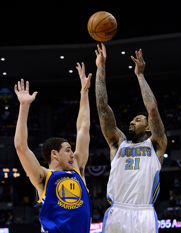 . Denver Nuggets shooting guard Wilson Chandler (21) shoots over Golden State Warriors shooting guard Klay Thompson (11) in the third quarter. The Denver Nuggets took on the Golden State Warriors in Game 5 of the Western Conference First Round Series at the Pepsi Center in Denver, Colo. on April 30, 2013. (Photo by AAron Ontiveroz/The Denver Post)