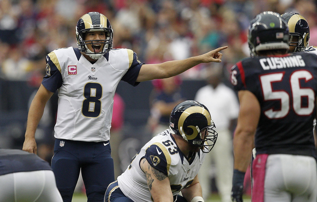 . Sam Bradford #8 of the St. Louis Rams calls out a play at the line against the Houston Texans at Reliant Stadium on October 13, 2013 in Houston, Texas.  (Photo by Bob Levey/Getty Images)