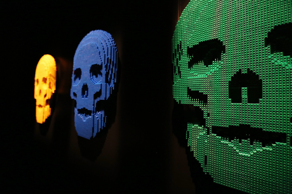 """. \""""Skulls,\""""  Nathan Sawaya sculptures, are displayed in the \'Art of the Brick\' show at Discovery Times Square on June 18, 2013 in New York City. (Photo by Mario Tama/Getty Images)"""