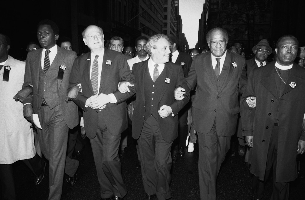 """. A procession on \""""National Day of Mourning\""""  is led on Fifth Avenue in New York on Saturday, Oct. 5, 1985.  Leaders in the procession are marching in protest of apartheid in South Africa.  Marchers are  from left: Oumarou G. Youssoufou, ambassador for the Organization of African Unity to the United Nations; New York\'s Mayor Ed Koch; National Association for the Advancement of Colored People\'s Director Dr. Benjamin Hooks; and New York\'s Police Commissioner Benjamin Ward. The group made its way to an ecumenical prayer service at Patrick\'s Cathedral.   (AP Photo/Rick Maiman)"""