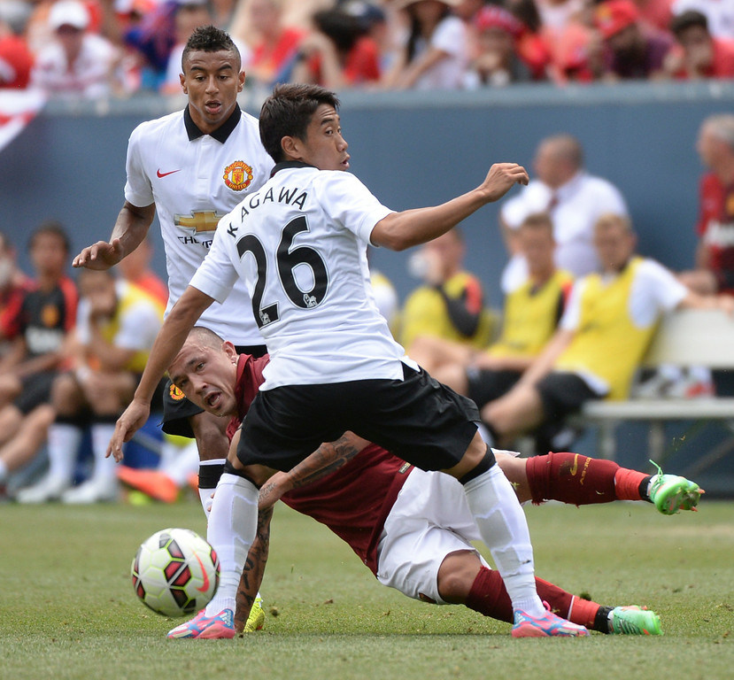 . Manchester United midfielder Shinji Kagawa (26) got tangled up with AS Roma midfielder Radja Nainggolan (4) in the second half. Manchester United defeated AS Roma 3-2 in an exhibition soccer game at Sports Authority Field in Denver Saturday afternoon, July 27, 2014. Photo by Karl Gehring/The Denver Post