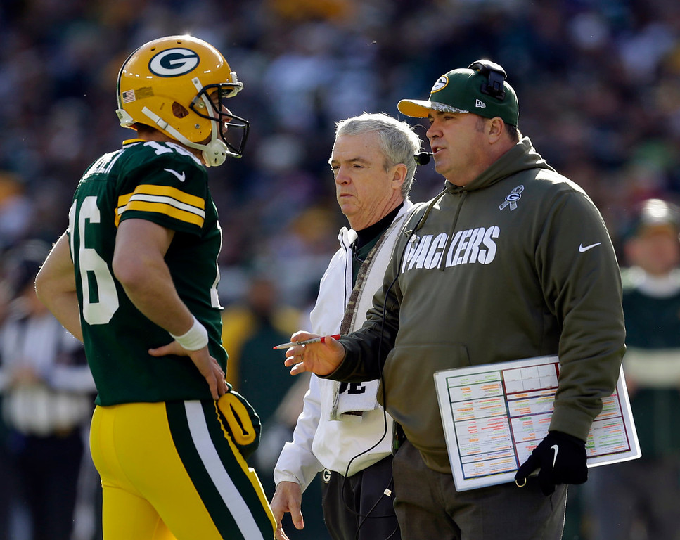 . Green Bay Packers head coach Mike McCarthy talks to quarterback Scott Tolzien during the first half of an NFL football game against the Philadelphia Eagles Sunday, Nov. 10, 2013, in Green Bay, Wis. Tolzien replaced injured quarterback Seneca Wallace earlier in the game. (AP Photo/Mike Roemer)