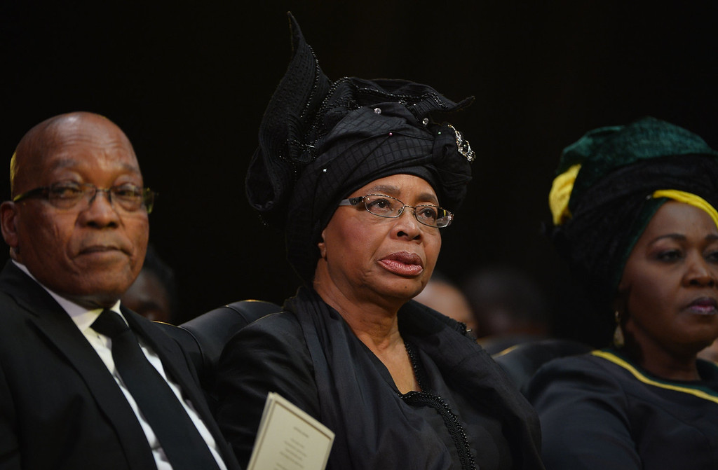 . The widow of Nelson Mandela, Graca Machel (C) and South Africa President Jacob Zuma (L) attend the funeral ceremony of South African former president Nelson Mandela in Qunu on December 15, 2013. Mandela, the revered icon of the anti-apartheid struggle in South Africa and one of the towering political figures of the 20th century, died in Johannesburg on December 5 at age 95.  AFP PHOTO / POOL / ODD ANDERSENODD ANDERSEN/AFP/Getty Images