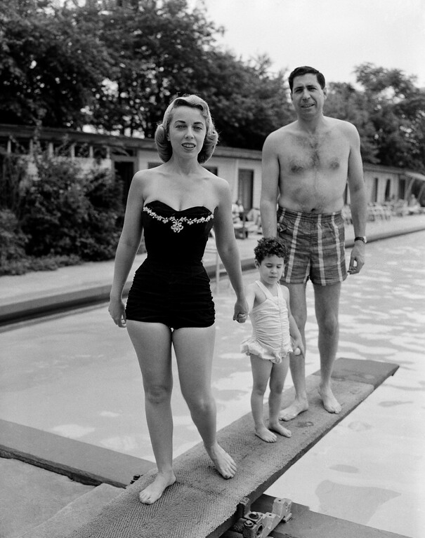 . Psychologist Dr. Joyce Brothers, left, is shown with her husband, Dr. Milton Brothers and their daughter, Lisa, 3, at the Goldman Hotel in Pleasantville, N.J. July 22, 1956, during a vacation. (AP Photo)