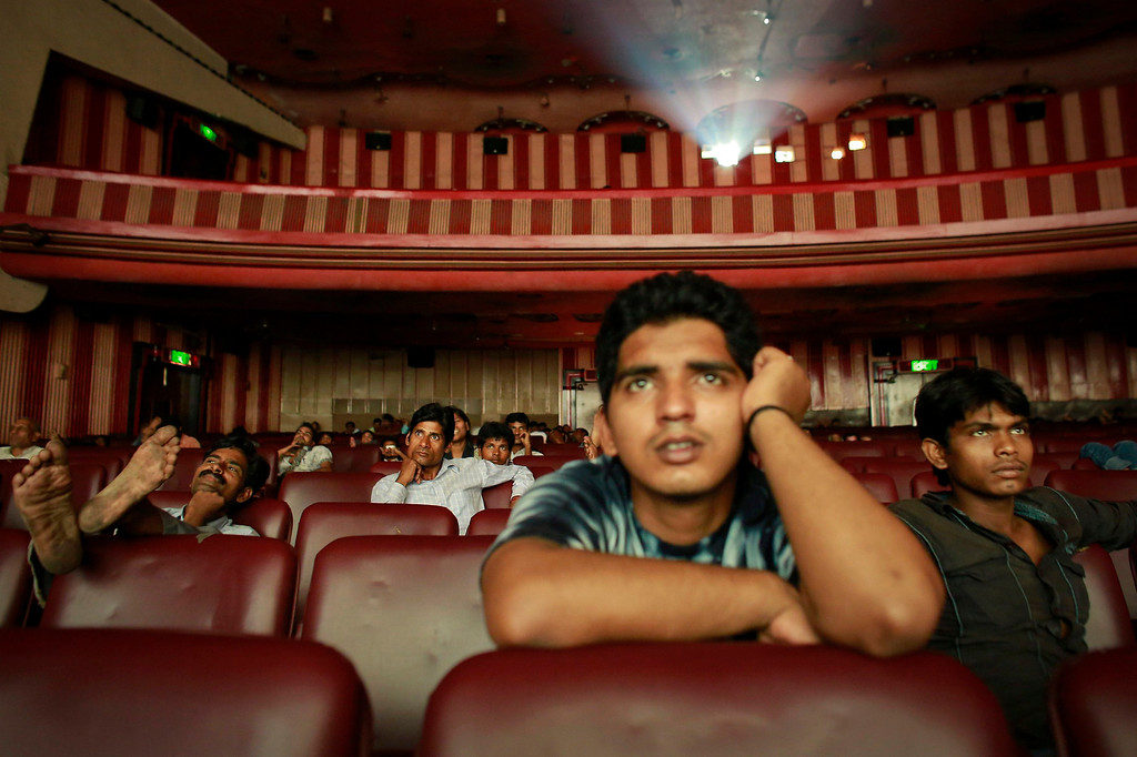 ". Ram Pratap Verma, a 32-year-old aspiring Bollywood film actor, watches a film at a cinema in Mumbai May 2, 2013. Bollywood is an addiction for many; an addiction that attracts thousands of aspiring stars to the city of Mumbai. Ram Pratap Verma made the journey from his small village eight years ago, and despite carrying his whole ""home\"" inside his bag, he is determined not to give up on his ambitions. He endeavours to watch at least one film a week at a cinema, where the silver screen keeps his dreams alive. Picture taken May 2, 2013. REUTERS/Danish Siddiqui"