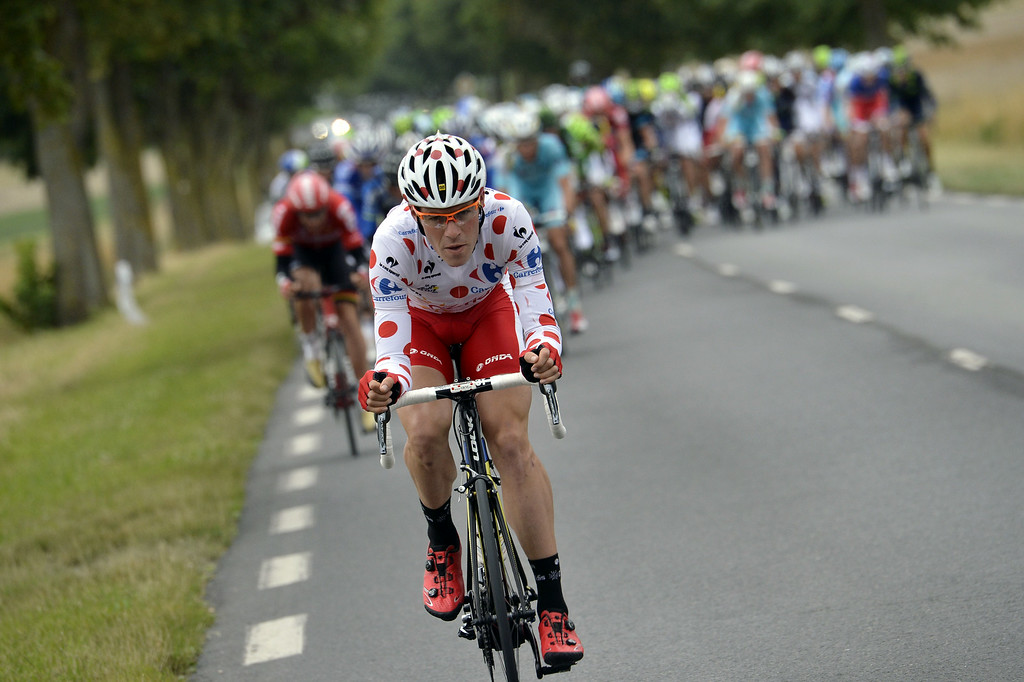 . France\'s Cyril Lemoine wearing the best climber\'s polka dot jersey rides in a breakaway during the 234.5 km seventh stage of the 101st edition of the Tour de France cycling race on July 11, 2014 between Epernay and Nancy, northeastern France.  AFP PHOTO / JEFF  PACHOUD/AFP/Getty Images