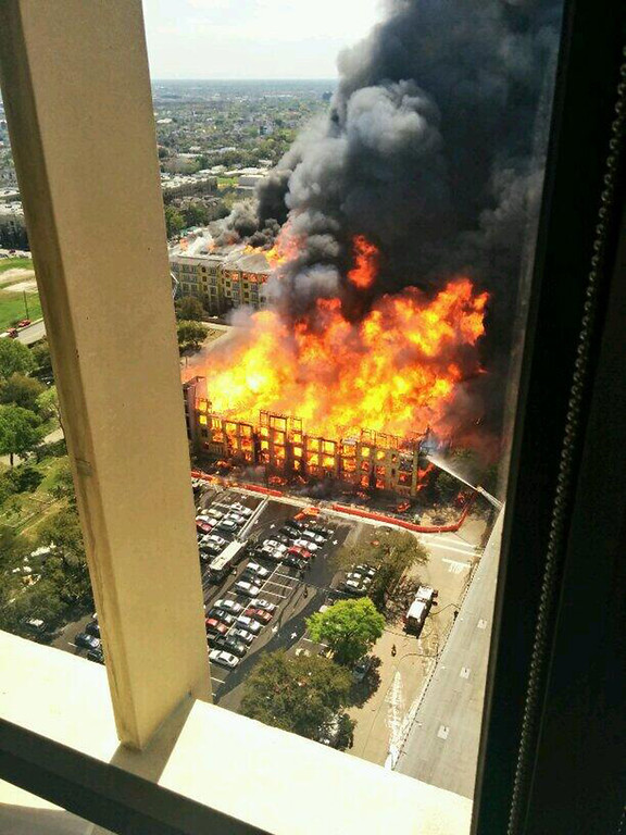 . In this photo provided by Christopher  Laski a large apartment complex under construction is consumed by fire, sending black smoke billowing into the sky and drawing hundreds of emergency personnel, Tuesday, March 25, 2014, in Houston. Houston fire officials say no injuries have been reported as a result of the dramatic blaze first reported about 12:30 p.m. Tuesday. (AP Photo/ Christopher  Laski)