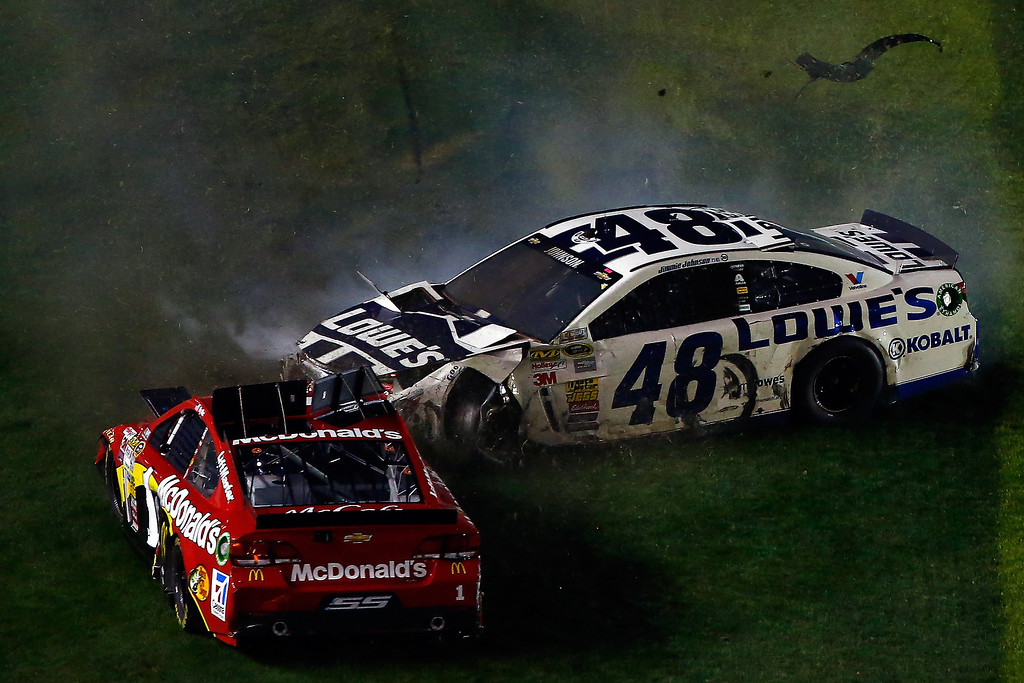 . Jamie McMurray, driver of the #1 McDonald\'s Chevrolet, and Jimmie Johnson, driver of the #48 Lowe\'s Chevrolet, are involved in an incident during the NASCAR Sprint Cup Series Budweiser Duel 2 at Daytona International Speedway on February 20, 2014 in Daytona Beach, Florida.  (Photo by Brian Lawdermilk/Getty Images)