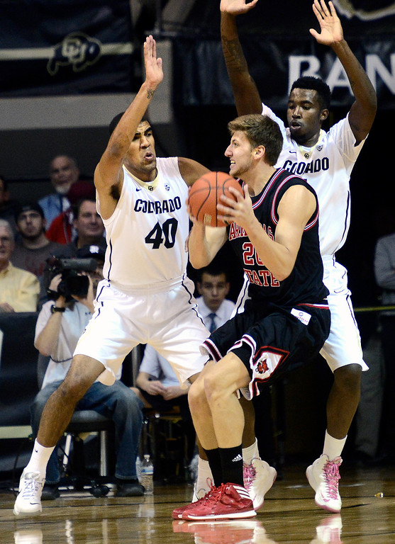 . University of Colorado\'s Josh Scott (40) and Wesley Gordon (1) guard against Arkansas State\'s Kirk Van Slyke (20)  during their game at the Coors Events Center on the CU Boulder Campus in Boulder, Colorado on November 18, 2013.  Photo by Paul Aiken / The Boulder Daily Camera.